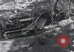 Image of Bulldozer clears road Burma, 1943, second 11 stock footage video 65675028820