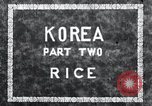 Image of Korean farmer irrigates rice field Korea, 1936, second 2 stock footage video 65675028850