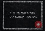 Image of korean farmer nails steel shoes to his bull Korea, 1936, second 3 stock footage video 65675028856