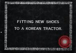 Image of korean farmer nails steel shoes to his bull Korea, 1936, second 4 stock footage video 65675028856