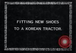 Image of korean farmer nails steel shoes to his bull Korea, 1936, second 5 stock footage video 65675028856
