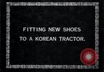Image of korean farmer nails steel shoes to his bull Korea, 1936, second 7 stock footage video 65675028856