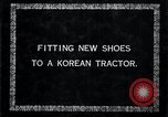 Image of korean farmer nails steel shoes to his bull Korea, 1936, second 8 stock footage video 65675028856