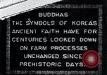 Image of Twin Stone carvings of Buddhas on Mount Chan-ji Korea, 1936, second 1 stock footage video 65675028857