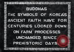 Image of Twin Stone carvings of Buddhas on Mount Chan-ji Korea, 1936, second 2 stock footage video 65675028857