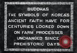 Image of Twin Stone carvings of Buddhas on Mount Chan-ji Korea, 1936, second 3 stock footage video 65675028857