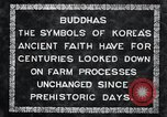 Image of Twin Stone carvings of Buddhas on Mount Chan-ji Korea, 1936, second 4 stock footage video 65675028857
