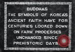 Image of Twin Stone carvings of Buddhas on Mount Chan-ji Korea, 1936, second 7 stock footage video 65675028857