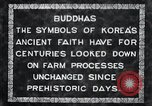 Image of Twin Stone carvings of Buddhas on Mount Chan-ji Korea, 1936, second 9 stock footage video 65675028857