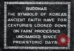 Image of Twin Stone carvings of Buddhas on Mount Chan-ji Korea, 1936, second 10 stock footage video 65675028857