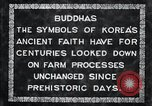 Image of Twin Stone carvings of Buddhas on Mount Chan-ji Korea, 1936, second 11 stock footage video 65675028857
