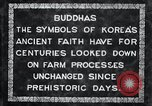 Image of Twin Stone carvings of Buddhas on Mount Chan-ji Korea, 1936, second 12 stock footage video 65675028857