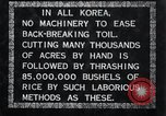 Image of threshing Korea, 1936, second 7 stock footage video 65675028861