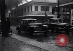 Image of cars moving in heavy rain Saigon Vietnam, 1955, second 5 stock footage video 65675028887