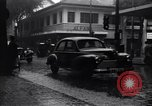 Image of cars moving in heavy rain Saigon Vietnam, 1955, second 6 stock footage video 65675028887