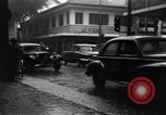 Image of cars moving in heavy rain Saigon Vietnam, 1955, second 7 stock footage video 65675028887