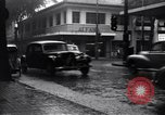 Image of cars moving in heavy rain Saigon Vietnam, 1955, second 8 stock footage video 65675028887