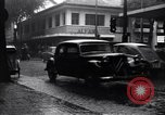Image of cars moving in heavy rain Saigon Vietnam, 1955, second 9 stock footage video 65675028887