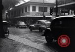 Image of cars moving in heavy rain Saigon Vietnam, 1955, second 10 stock footage video 65675028887