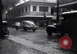 Image of cars moving in heavy rain Saigon Vietnam, 1955, second 11 stock footage video 65675028887