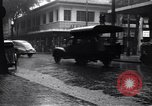 Image of cars moving in heavy rain Saigon Vietnam, 1955, second 12 stock footage video 65675028887