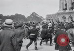 Image of large crowd Versailles France, 1919, second 2 stock footage video 65675029030
