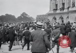 Image of large crowd Versailles France, 1919, second 3 stock footage video 65675029030