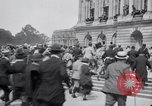 Image of large crowd Versailles France, 1919, second 4 stock footage video 65675029030
