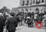 Image of large crowd Versailles France, 1919, second 7 stock footage video 65675029030