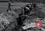 Image of burial pit Arnstadt Germany, 1945, second 10 stock footage video 65675029051