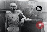 Image of piled up corpses Mauthausen Austria, 1945, second 12 stock footage video 65675029086