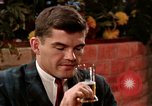 Image of drinking and eating United States USA, 1964, second 3 stock footage video 65675029101
