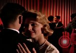 Image of couples dancing and drinking during sexual revolution United States USA, 1964, second 7 stock footage video 65675029108