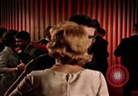 Image of couples dancing and drinking during sexual revolution United States USA, 1964, second 12 stock footage video 65675029108
