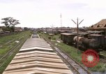 Image of railroad yard Saigon Vietnam, 1967, second 3 stock footage video 65675029138