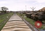 Image of railroad yard Saigon Vietnam, 1967, second 5 stock footage video 65675029138