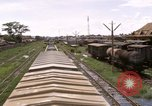 Image of railroad yard Saigon Vietnam, 1967, second 6 stock footage video 65675029138