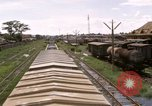Image of railroad yard Saigon Vietnam, 1967, second 7 stock footage video 65675029138