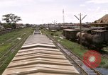 Image of railroad yard Saigon Vietnam, 1967, second 9 stock footage video 65675029138