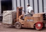 Image of loading-unloading of supplies Saigon Vietnam, 1967, second 6 stock footage video 65675029144