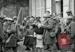 Image of US Army troops with French children in World War 1 France, 1918, second 2 stock footage video 65675029238
