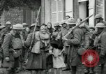 Image of US Army troops with French children in World War 1 France, 1918, second 5 stock footage video 65675029238