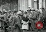 Image of US Army troops with French children in World War 1 France, 1918, second 7 stock footage video 65675029238