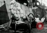 Image of Unloading flour bags from freighter  Archangel Russia, 1918, second 2 stock footage video 65675029275