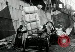 Image of Unloading flour bags from freighter  Archangel Russia, 1918, second 9 stock footage video 65675029275