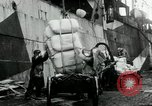 Image of Unloading flour bags from freighter  Archangel Russia, 1918, second 10 stock footage video 65675029275