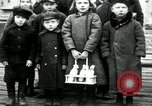 Image of Russian children receive coins Archangel Russia, 1918, second 1 stock footage video 65675029276