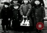 Image of Russian children receive coins Archangel Russia, 1918, second 2 stock footage video 65675029276