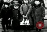 Image of Russian children receive coins Archangel Russia, 1918, second 4 stock footage video 65675029276