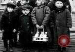 Image of Russian children receive coins Archangel Russia, 1918, second 6 stock footage video 65675029276